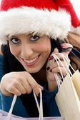 Christmas woman holding shopping bags — Stockfoto