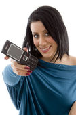 Female showing mobile at camera — Stock Photo