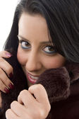 Female model covering face with overcoat — Stock Photo