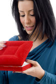 Female looking into jewellery box — Stock Photo