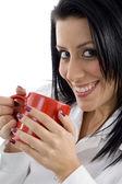 Beautiful woman sipping coffee — Stock Photo