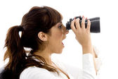 Shocked female viewing through binocular — Stock Photo