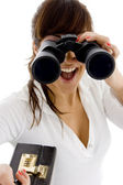 Female viewing through binoculars — Stock Photo
