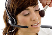 Customer care executive applying blush — Stock Photo