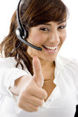 Smiling service provider with thumbs up — Stock Photo