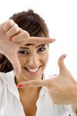 Smiling executive framing her face — Stock Photo