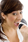 Female singing into microphone — Stock Photo