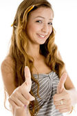 Smiling teenager student with thumbs up — Stock Photo