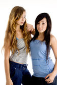 Young pretty girls looking at camera — Stock Photo