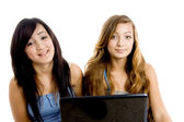 School girls with laptop, smiling — Stock Photo