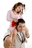 Girl sitting on father's shoulder — Stock Photo