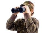 Front view boy viewing through binocular — Stock Photo