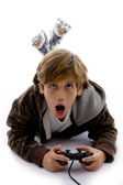 Urprised kid playing videogame — Stock Photo