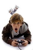Urprised kid playing videogame — Stock Photo