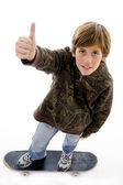Top view of boy riding skateboard — Stock Photo
