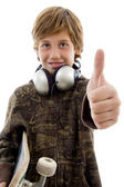 Boy with headphone and thumbs up — Stock Photo