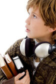 School boy with books and headphones — Stock Photo