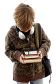 School boy with books and headphones — Stock Photo