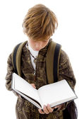 School child reading a book — Stock Photo
