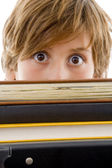Eye level view of boy with books — Stock Photo