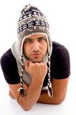 Fashionable man posing in woolen hat — Stock Photo
