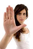 Beautiful woman showing stop gesture — ストック写真