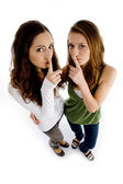 High angle view of girls shushing — Stock Photo