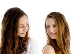 Portrait of girls looking to each other — Stock Photo