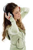 Attractive female enjoying music — Stock Photo