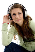 Attractive female enjoying music — Stock Photo