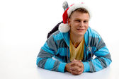 Youth inchristmas hat looking at camera — Stock Photo
