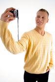 Handsome guy clicking his snap — Stock Photo
