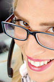 Smiling female customer care provider — Stock Photo