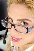 Female telecaller looking at camera — Stock Photo