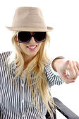 Woman in hat pointing at camera — Stock Photo