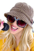 Glamorous woman singing into mic — Stock Photo