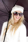 Beautiful woman holding an umbrella — Stock Photo
