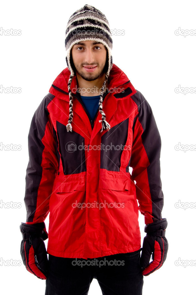 Young man in woolen cap and winter jacket on an isolated white background — Stock Photo #1670031