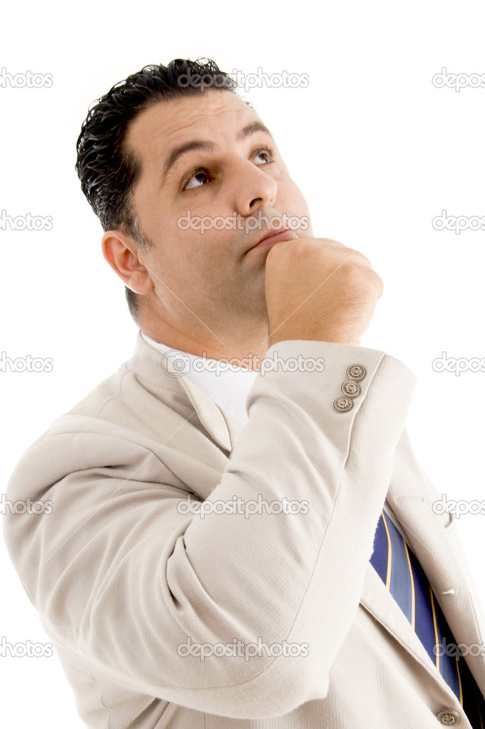 Pose of considering businessman with clenched fist  Stock Photo #1672899