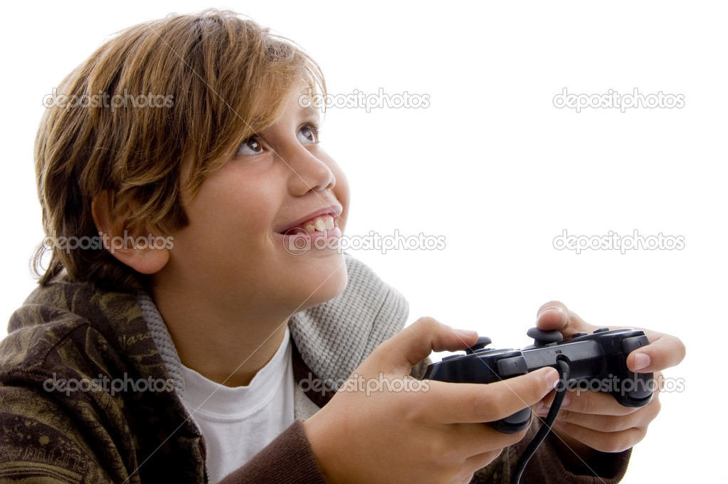 Side view of young boy playing video games on an isolated background — Stock Photo #1673358