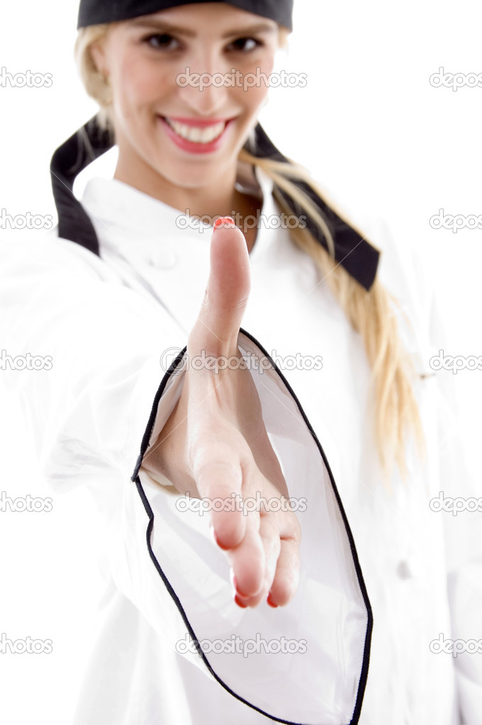 Front view of smiling chef offering handshake against white background — Stock Photo #1676825