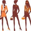 Fashionable female silhouettes — Stock Vector