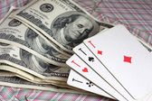 Dollars and 4 aces — Stock Photo