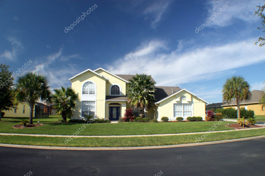 A new home with blue sky and palm trees.  Stock Photo #1374660