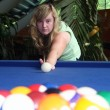 Lucy playing american pool - Foto Stock