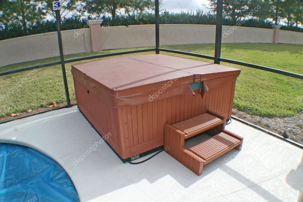 A Hot Tub near to a Pool in a Florida Home.  Stock Photo #1408950