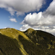 Austrian Alps with puffy clouds — Stock Photo