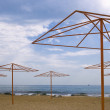 Shore with beach umbrellas - Stock Photo