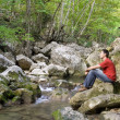Royalty-Free Stock Photo: Man sits at river