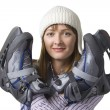 Happy young woman with ice-skates — Stock Photo